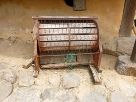 A traditional machine for separating rice from the chaff.