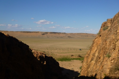 The view from just outside the cave mouth. The mound in the distance is the Uush sand dune.