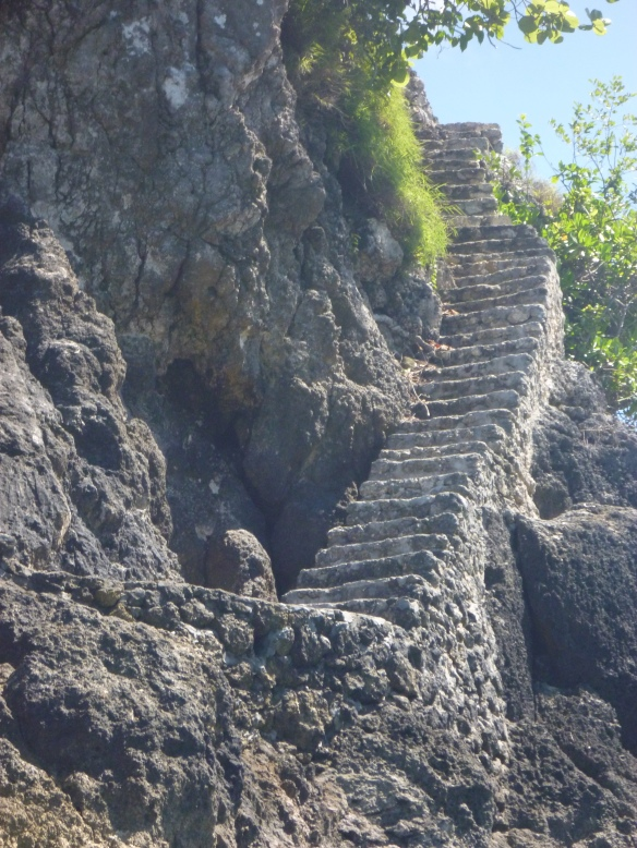 Stairs up to a temple on a tiny island.