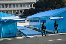Between each of the conference buildings there were several American and North Korean guards watching the North.