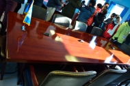 The microphones on the table are the demarcation line between north and south.