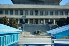 It is possible to see a North Korean guard at the top of the steps.