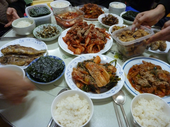 A traditional lunch spread to test the kimchi -- apparently the first round was too salty so more radish was added.